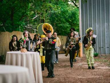 The Minor Mishap Marching Band leads a recessional outside
