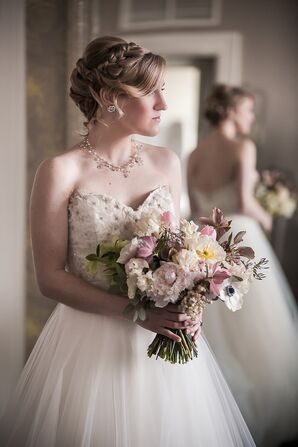 Bride with Intricate Hairstyle and Wedding Jewelry
