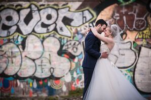 Newlyweds in Front of Philadelphia Graffiti
