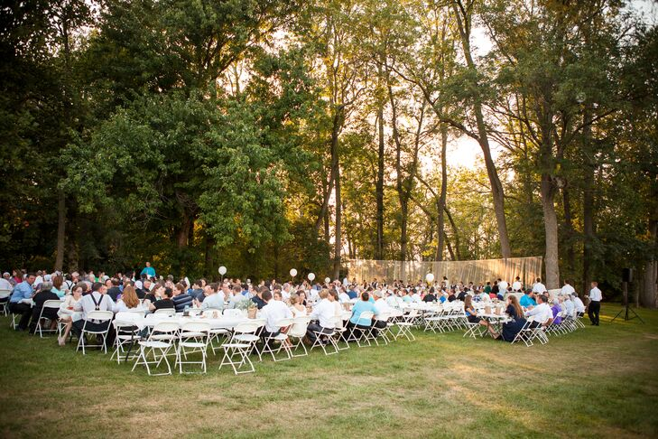 """""""I've always dreamed of having an outdoor wedding since I was a little girl,"""" says Christina. """"We had the ceremony in a beautiful church two miles from my parent's place and the reception was held outdoors in a meadow on our neighbor's property near a creek. Our dream was a rustic environment with vintage details."""""""