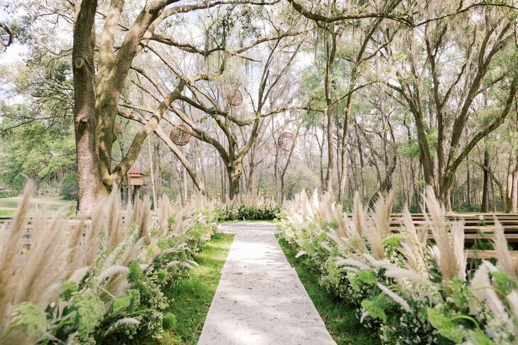 Backyard Ceremony Site with Pampas Grass Aisle Decorations