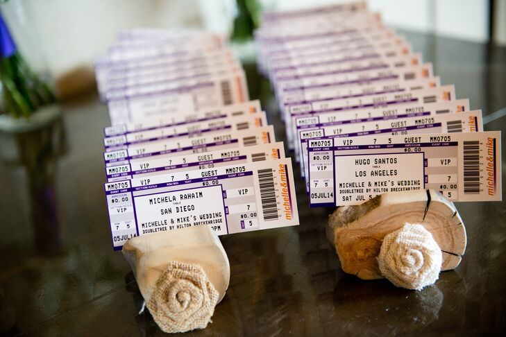 The concert tickets were made to look like concert tickets to commemorate the concert where they first met and the table numbers were cities the couple has traveled to rather than numbers.