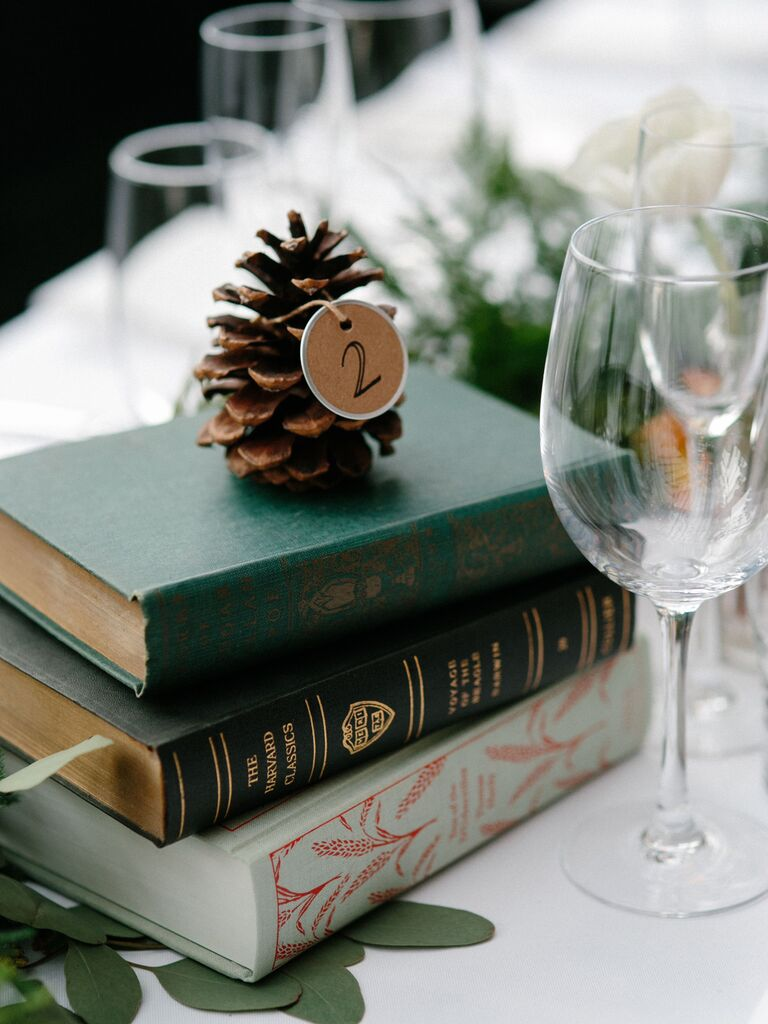 vintage book and pinecone centerpieces