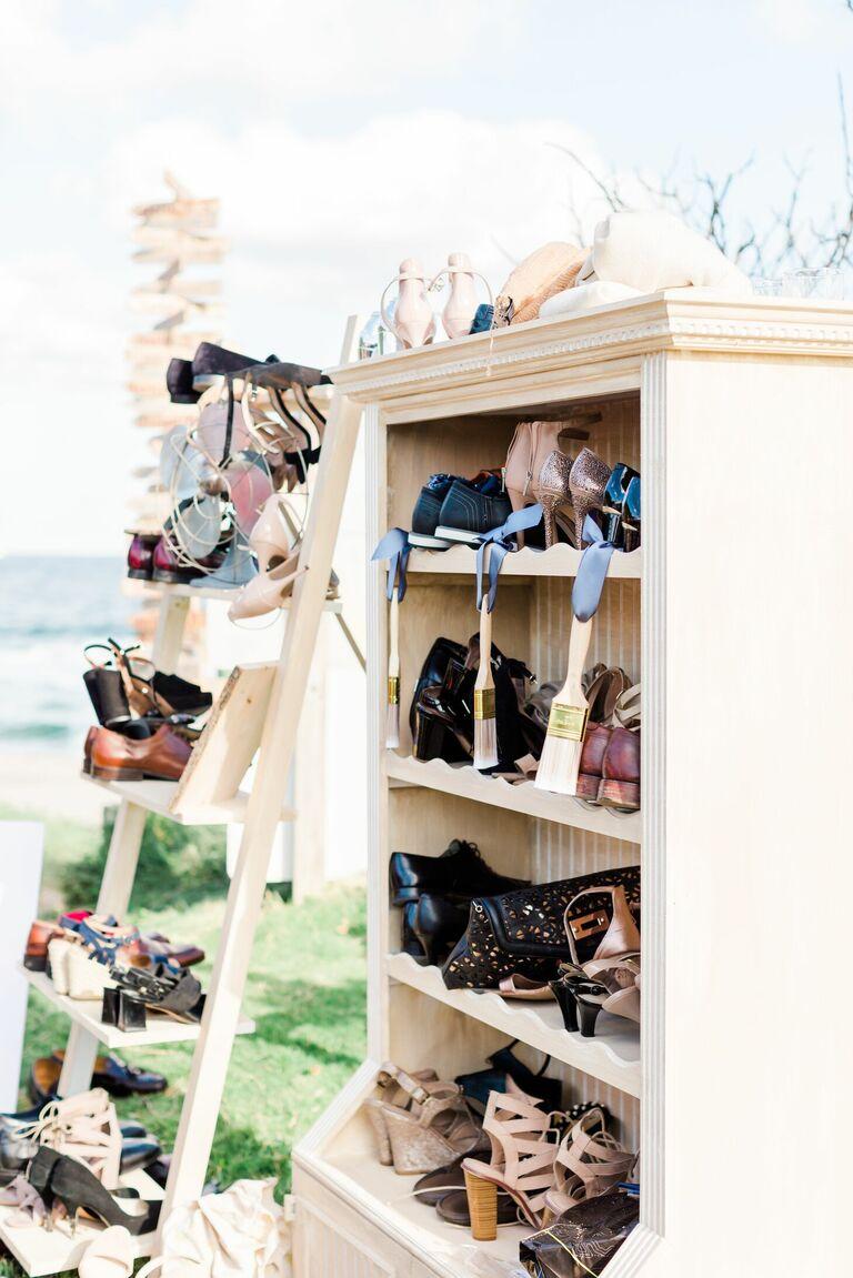 Shelves for shoe check at beach wedding