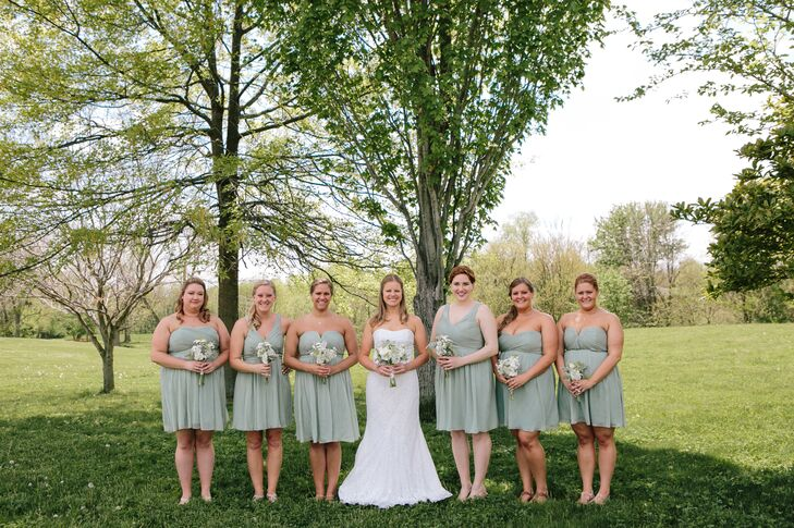 """My bridesmaids wore mismathed J. Crew dresses in Dusty Shale, my favorite color in our wedding,"" Amy explains of her love for the muted green color."