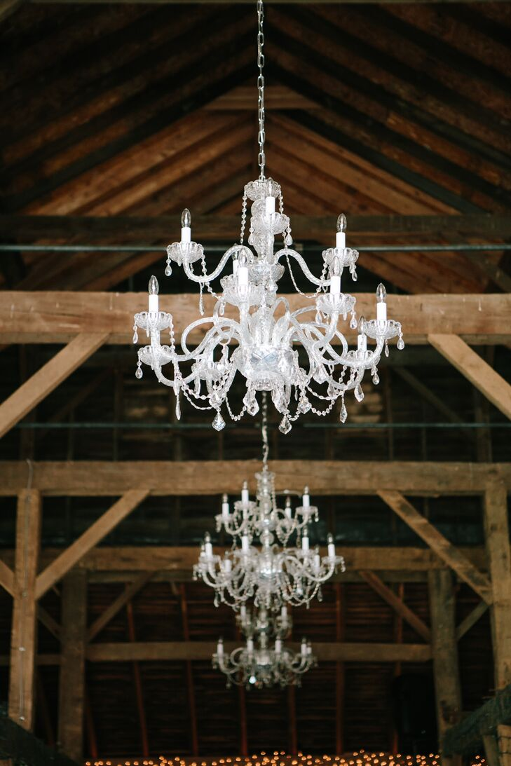 Chandeliers hung from the ceiling inside the barn providing a touch of elegance to an otherwise rustic environment.