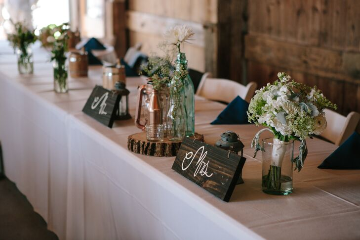 "Amy and Ryan not only showed their love for nature by having an outdoor ceremony. ""Scattered throughout the tables were green and rose gold camp lanterns, a representation of our love of camping and the outdoors,"" Amy explains."
