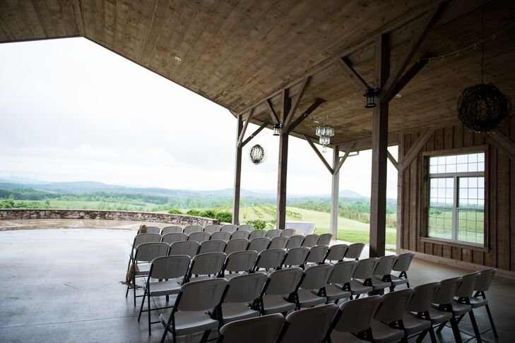 """Our wedding theme was all about reflecting the mountains around us,"" says Rachel. ""We choose a beautiful outdoor venue that was filled with natural decoration- the vineyards, the soaring roof of the barn and the Mason jar chandeliers hanging from the rafters."""