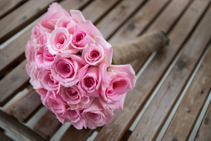 "The couple planned to have garden roses but the blooms they ordered online dropped all of their petals on the day of the wedding. ""We made an emergency run to Cosco and bought every pink rose they had instead,"" says Rachel. ""Regular pink roses are my favorite flower now—these things happen and you have to roll with it!"""