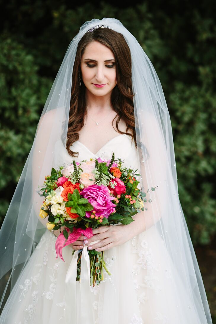Brightly colored blooms were key for Amanda's bouquet, which was crafted by local florist Kathy Buffandeau.