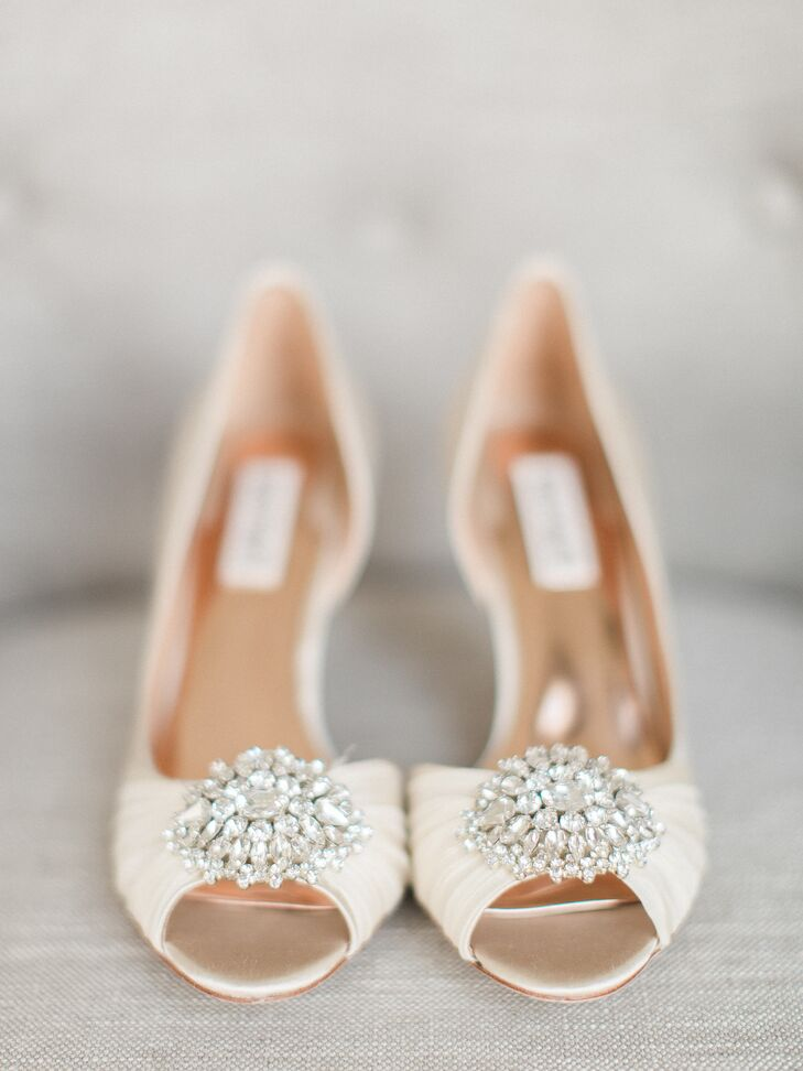 Katlyn accessorized with a pair of Badgley Mischka cream heels complete with a glam brooch detail.
