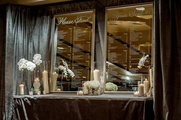 Wedding coordinators Brock & Co. Events worked with Townsley Designs to create mirrored signs and white lounge seating throughout the reception, which added to the winter wonderland ambience.