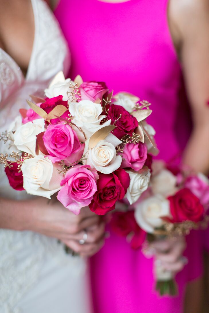 Talk about pink! Her bridal bouquet took their wedding color to a new level with bold fuchsia, white and burgundy roses. To bring in her love of gold, gold-painted seeded eucalyptus also popped from within the bouquet.