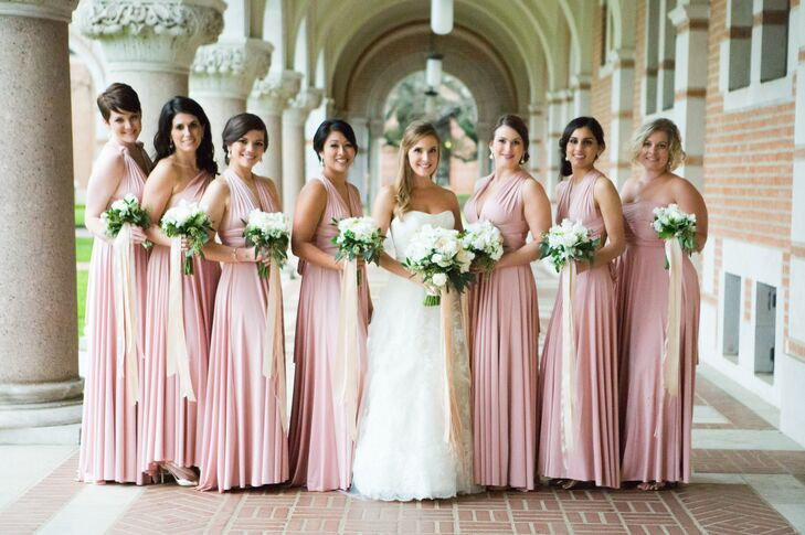 The bridesmaid dresses wore blush; their dresses were the only pops of color throughout the wedding's classic black and white palette.