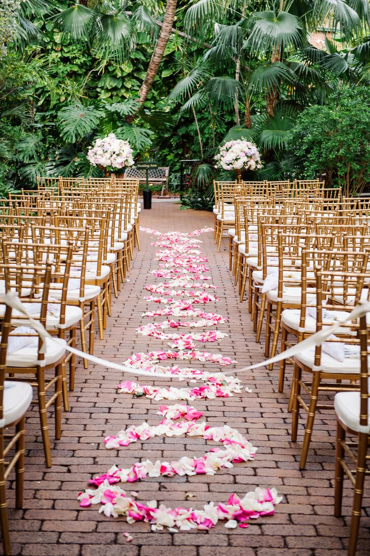 The exposed-brick ceremony aisle was decorated with pink and white rose petals in a scroll pattern for a touch of drama and romance.