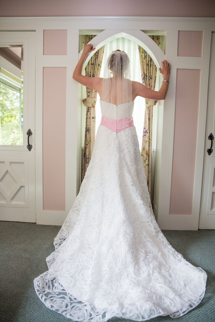 Lisa wore a strapless white dress with a cathedral length lace veil and a light pink sash.