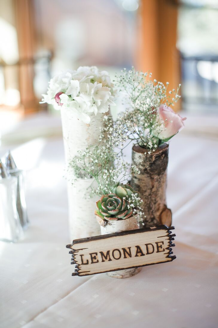 Justin made the wooden centerpieces, which held the flowers (roses, hydrangeas, baby's breath and succulents). Each table was named after a theme park treat or detail from Disneyland (where Lissette and Justin met—at a lemonade stand).