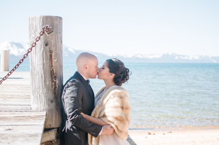 "Lissette wore a vintage fur stole she found on a previous trip to Lake Tahoe with a snowflake brooch from her mother (her ""something old"") to complete her winter bridal style."