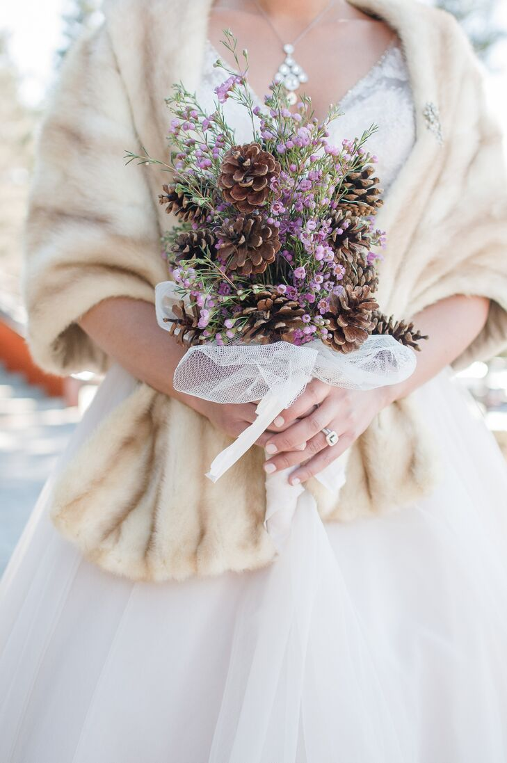 Lissette carried a DIY bouquet of purple wildflowers and pinecones that tied in the natural winter scenery at Lake Tahoe.