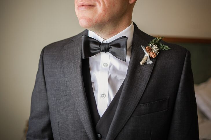 Justin wore a rustic, wintery boutonniere with a pair of mini pinecones and a sprig of evergreen, tied with hemp.
