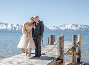 The snow-capped mountains around Lake Tahoe provide a breathtaking view on any day, but for a winter wedding, they make for an especially romantic bac