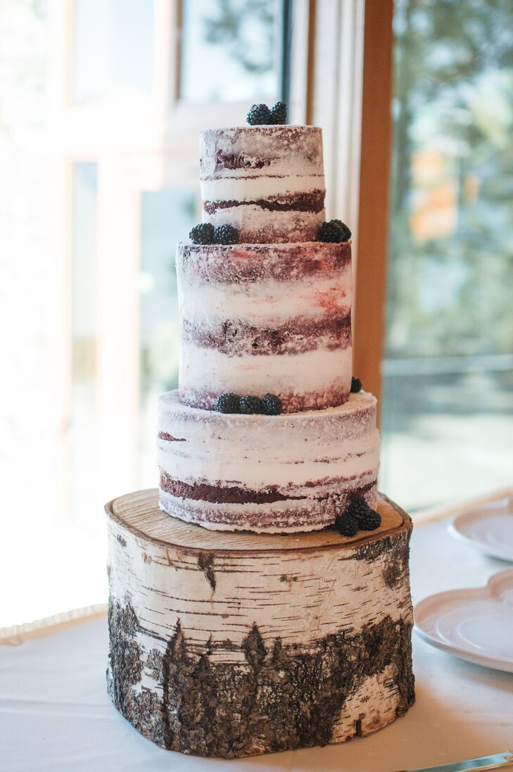 Lissette is an expert baker and owner of Dolled-Up Cakes by Lissette, so naturally, she made her own wedding cake. This stunning red velvet naked cake matched the birch wood cake stand and the rustic, natural surroundings.