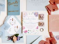 pastel wedding invitations and vow books