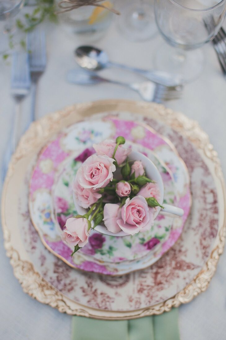 Vintage floral patterned china complemented the romantic garden setting of the wedding.