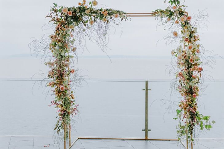 Romantic, Whimsical Wedding Arch with Pink Roses and Branches