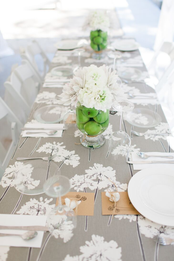 Madison loved the way fresh green apples evoked the green in the floral centerpieces. She placed them in glass vases atop hand-sewn gray table linens on each dining table.