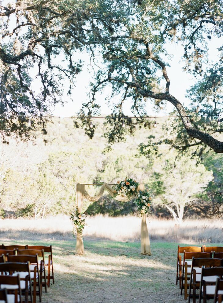 Ceremony Arch with Yellow Draping at The Ivory Oak in Wimberley, Texas