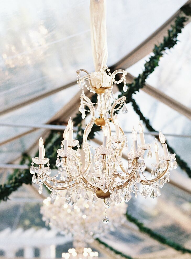 The clear reception tent placed in the gardens was lit with lots of votives and five lavish chandeliers mimicking the internal decor of the Duke Mansion to give the illusion of bringing some of the inside out.