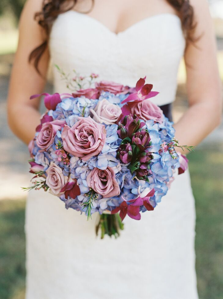 Beautiful Kreations, the couple's florist, designed a Cassandra's bright bouquet, which matched the couple's Parisian theme and the rest of their floral accents. She carried an arrangement of mauve and blush roses, fuchsia orchids and blue hydrangeas with a line of fun purple alstroemerias tucked into the center. Each bloom was wrapped with an ivory ribbon to match her dress.