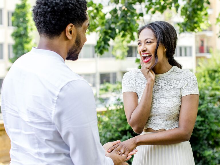 Couple getting engaged outside