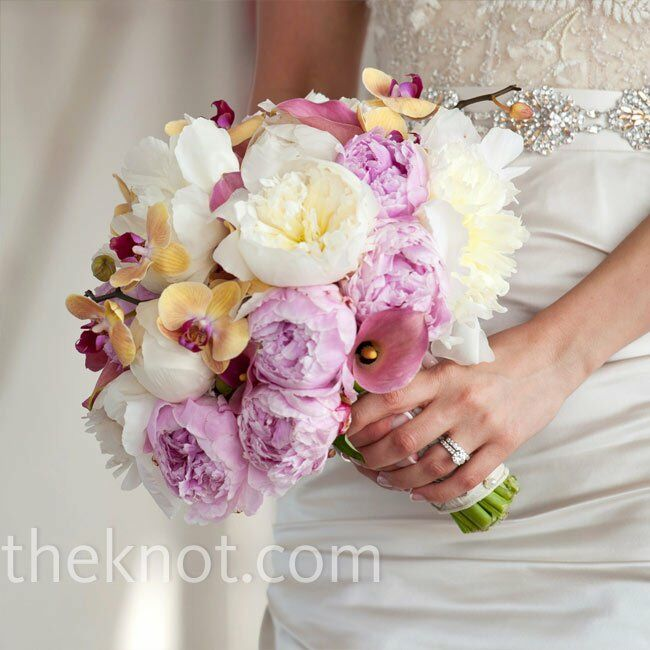 Gold and magenta orchids made Cara's lush bouquet of popular springtime flowers (peonies and calla lilies) stand out.