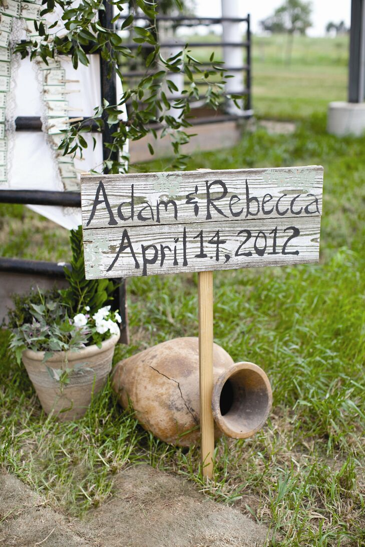 Weathered wooden signs announced the couple's names and wedding date.