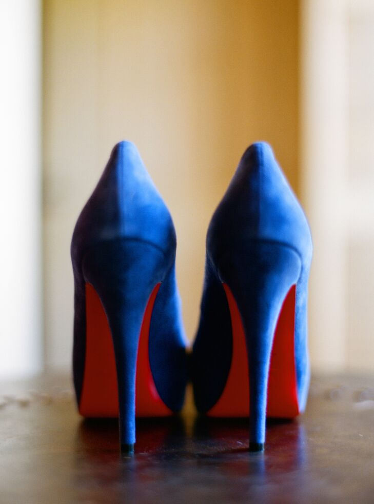 Talia's navy velvet Christian Louboutin peep-toe pumps had a light blue insert to represent her something new, given to her by her maid of honor. The signature red soles provided an extra pop of color.