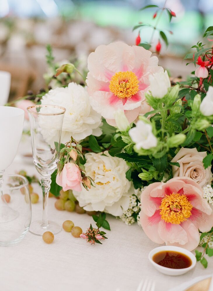 Gold-rimmed glasses added a celebratory touch to the lush tablescapes.