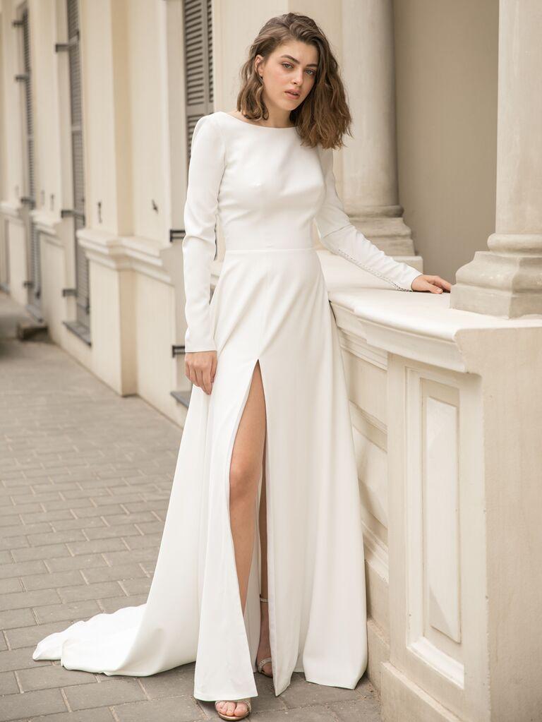 Dana Harel Spring 2020 Bridal Collection long-sleeve wedding dress with high leg slit