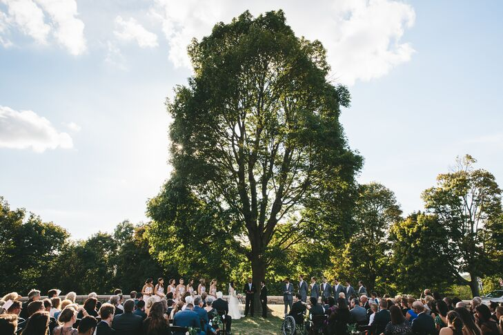 Jordan and Jacob said their vows under a large tree in Larz Anderson Park in Brookline, Massachusetts. Decorations were minimal, allowing the space to be the focus.