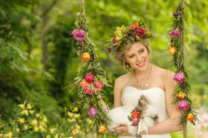 Chelish Moore Flowers created a lush flower crown from bright red roses, green orchids and various types of greenery for the bride. Paired with her loose, romantic updo, the crown added a bohemian touch to her look.