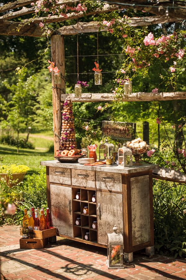 Vintage furniture provided the base for displaying an array of playful desserts, like a donut tower and biscuit bar by Two Guys N A Kitchen.