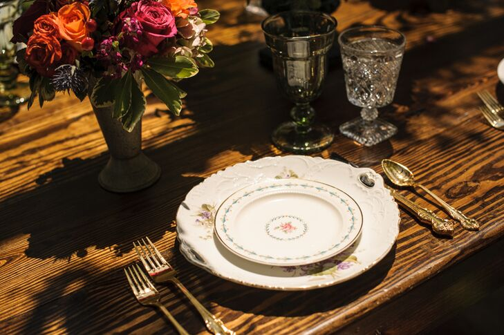 For a dainty, feminine touch, Heirloom for Hire provided vintage floral dinnerware, which Simply Styled stacked at each place setting alongside brass cutlery and etched glasses.