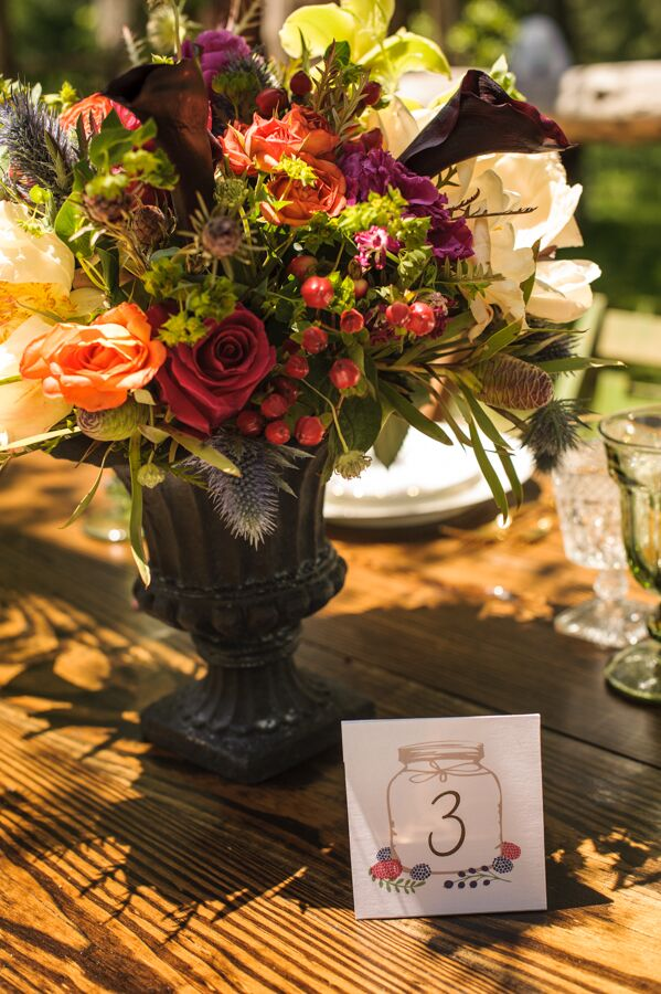 The tables were marked by quaint table numbers featuring illustrated mason jars and dainty hand-drawn flowers created by the designers at Dazzle & Delight.