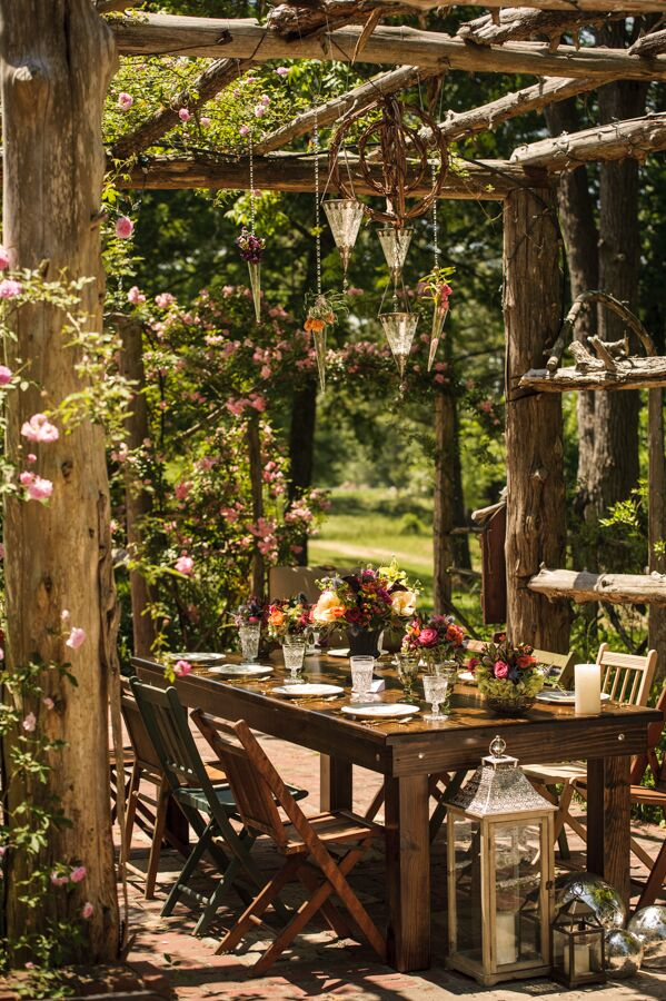 The reception tables were tucked away under a rustic pergola surrounded by lush greenery and colorful wildflowers. The intimate setting lent the shoot a romantic air and would be the perfect spot for an evening reception, candles casting a warm glow over the space as the sun goes down.