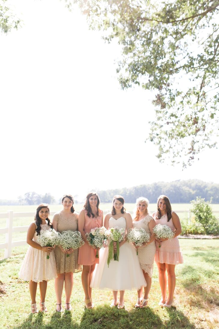 Playing off the wedding's laid-back vibe, Alix and George decided to let their bridesmaids and groomsmen choose their own attire. The girls were able to wear their own dresses, sticking to soft shades of pink and cream with ruffles and lace accents adding a flirty, feminine feel to their look.