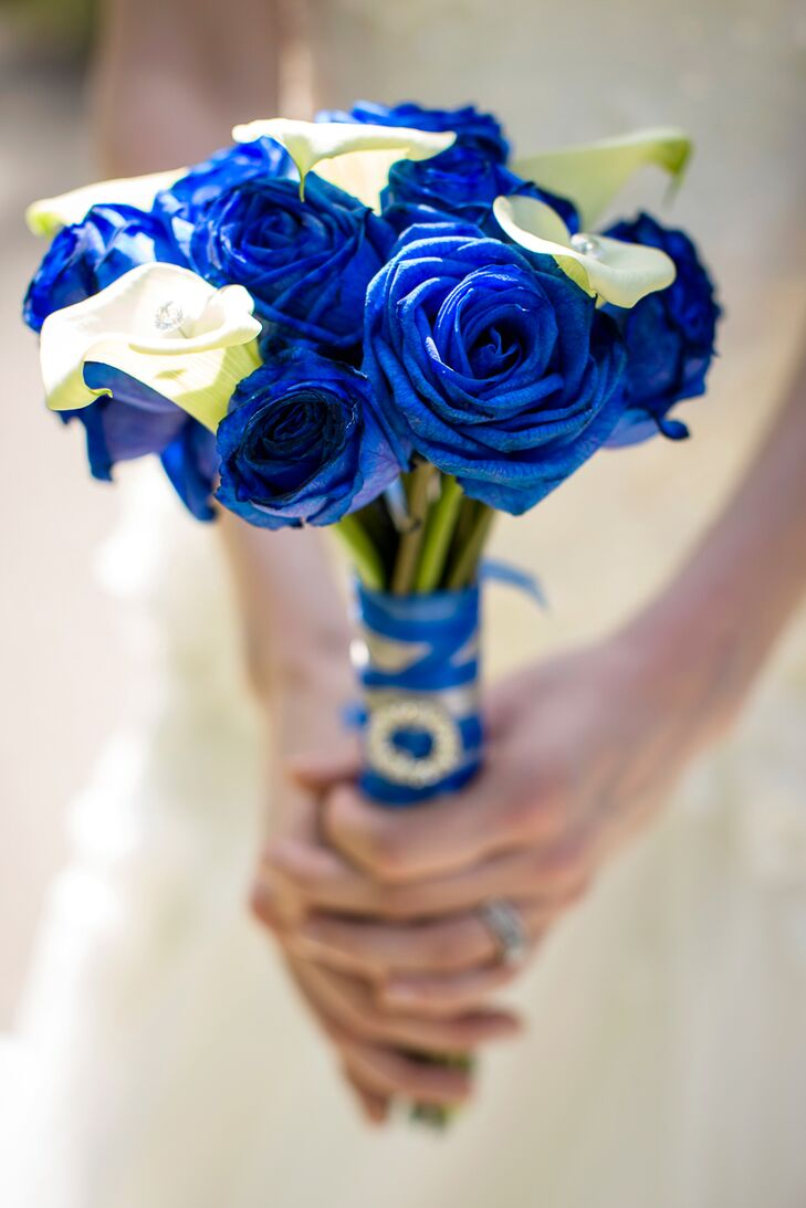 Joni carried a small bouquet of dyed blue roses and white calla lilies tied together with a blue ribbon.
