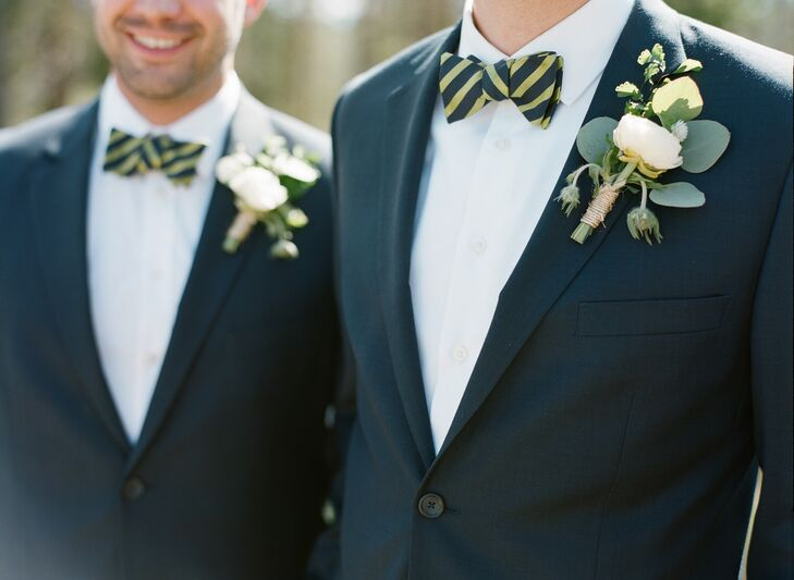 Alex and his groomsmen accessorized their navy suits with olive green striped bow ties from Ted Baker London.