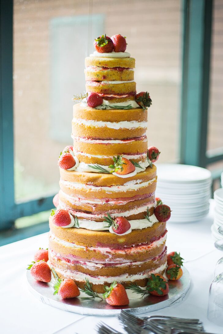 After a lunch of tea-party-inspired fare, including tea sandwiches, salads and scones, guests indulged in a slice of white cake with vanilla buttercream and strawberries. Tying into the day's British undercurrents, the cake was inspired by Emma's love of Victoria sponge cake.