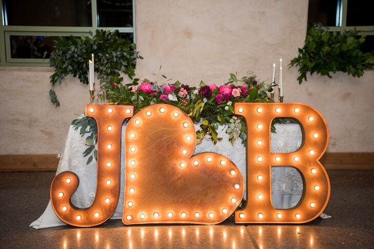 A custom made sign with Jenna's and Brett's initials faced the dance floor at the indoor reception at Springs Preserve in Las Vegas, Nevada.